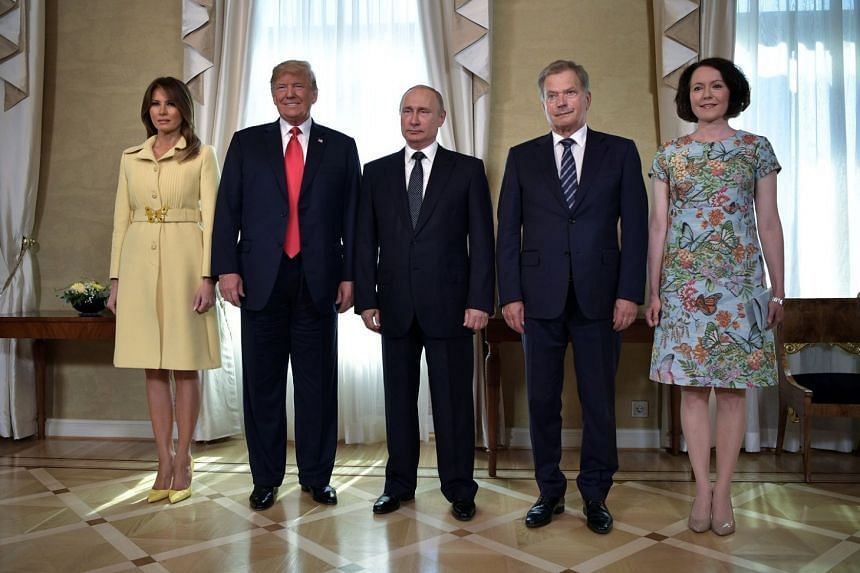 US President Donald Trump and his wife Melania with Russian President Vladimir Putin (centre), Finnish President Sauli Niinisto and his wife Jenni Haukio in the Finnish capital yesterday. Mr Trump and Mr Putin are in Helsinki for a one-on-one summit.