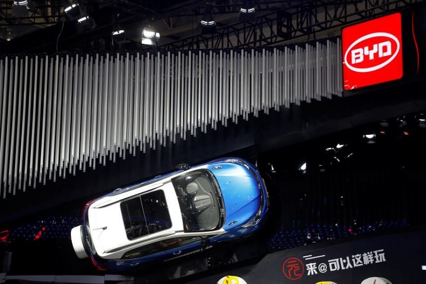A BYD hybrid electric SUV model is displayed during the Auto China 2016 auto show in Beijing. BYD was reportedly forced to refuse payment on contracts worth 1.1 billion yuan (S$224 million).