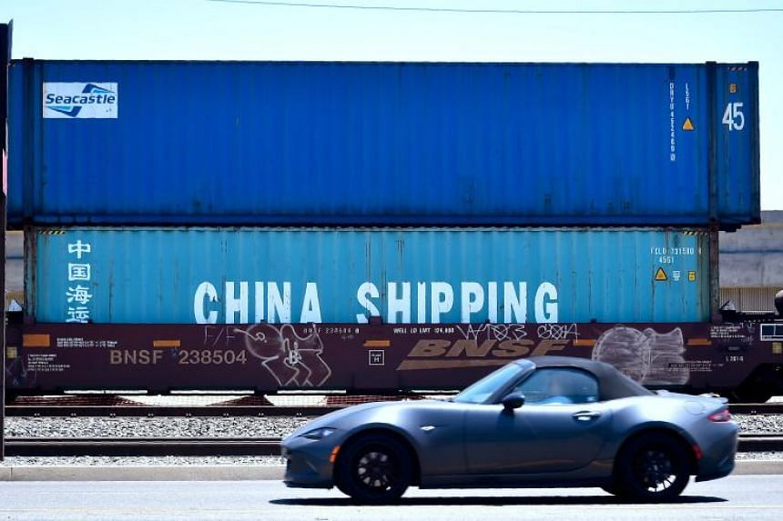 Shipping containers, including one from China Shipping, await transportation on a rail line at the Port of Long Beach on July 12, 2018 in Long Beach, California.