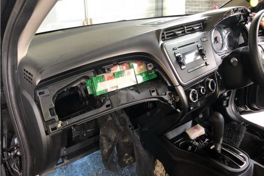 Duty-unpaid cigarettes were hidden in a modified dashboard, fuel tank and floorboard of a Malaysia-registered car.