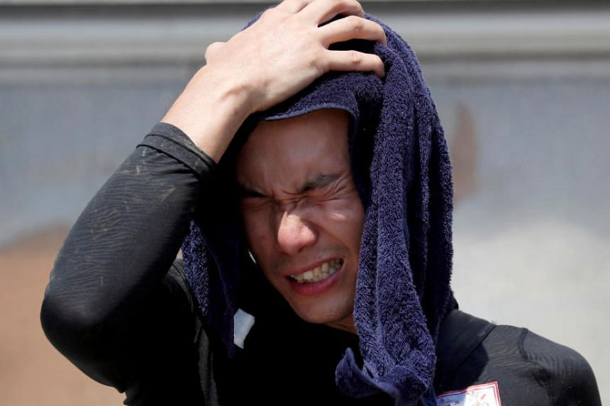 A volunteer wipes his sweat as he takes a break in a heat wave at a flood affected area in Kurashiki, Okayama Prefecture, Japan, on July 14, 2018.