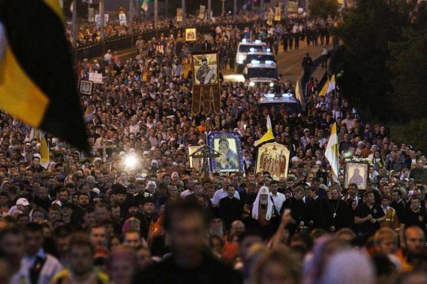 Russian Orthodox Patriarch Kirill (centre, in white) leads believers in a nighttime procession marking 100 years since the Bolsheviks shot dead Tsar Nicholas II and his family outside Yekaterinburg, early on July 17, 2018.