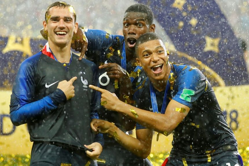 From left: Antoine Griezmann, Paul Pogba and Kylian Mbappe celebrating after France beat Croatia 4-2 in the World Cup final in Moscow on July 15, 2018. Pogba's parents are from Guinea while Mbappe's parents are Cameroonian and Algerian.