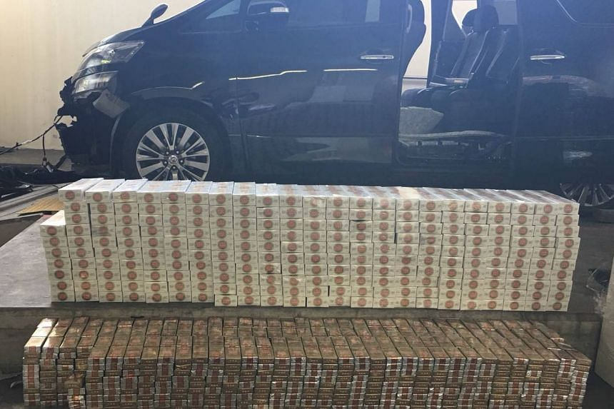A total of 227 cartons and 1,366 packets of duty-unpaid cigarettes were found and seized from a modified Malaysia-registered car that was driven by a Malaysian woman.