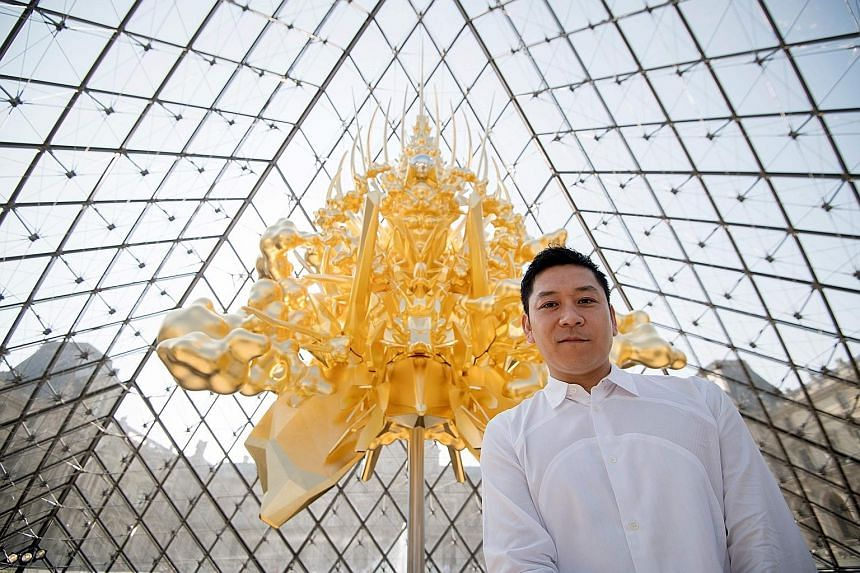 Japanese sculptor Kohei Nawa has installed a monumental hanging gold throne at the Louvre museum in Paris as part of Japonismes 2018.
