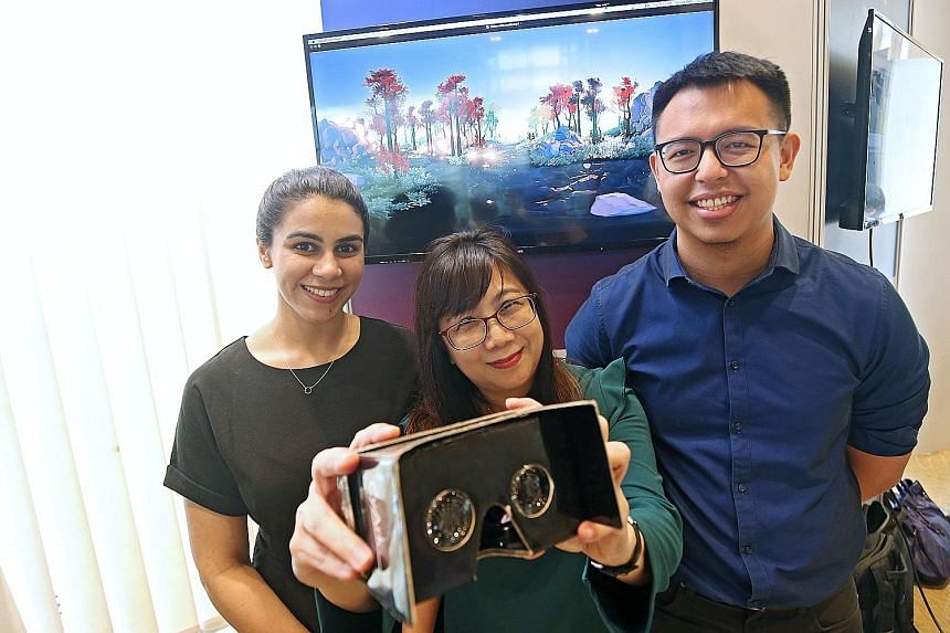 Mages Studio growth strategist Vrinda Bahl, SGH genetic counsellor Carol Loi and National Cancer Centre medical social worker Ng Yong Hao, with the headset that aims to reduce anxiety in patients facing surgery.