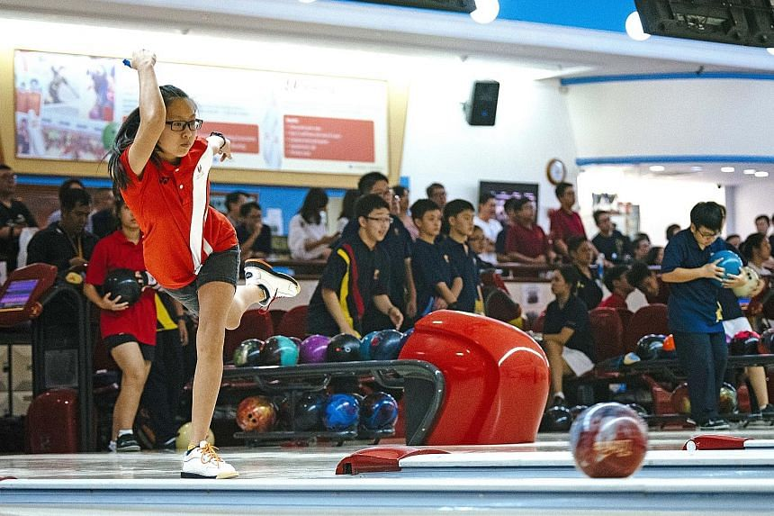 Shirlene Wong of the Singapore Sports School on a roll at the National Schools C Division bowling finals held at Orchid Country Club yesterday.