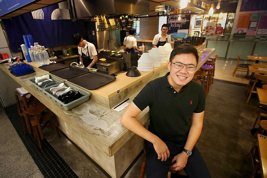 Mr Melvin Ang at Kanshoku Ramen at Orchard Gateway, the ramen chain that he runs. The 29-year-old has found success in the food and beverage business in spite of his difficult growing-up years - his father was a gambler who owed loan sharks hundreds
