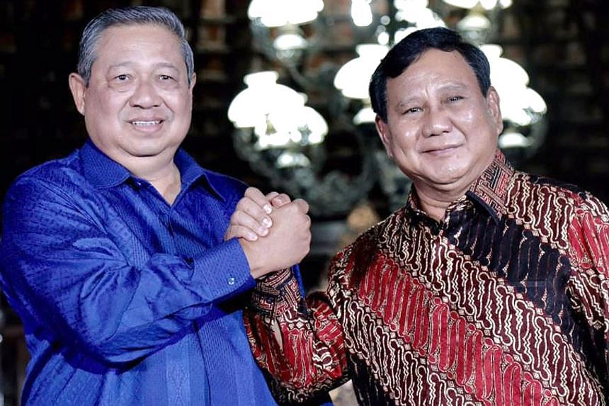 Above: Dr Susilo Bambang Yudhoyono (in blue shirt) and Mr Prabowo Subianto are set to meet tonight to discuss joining forces, sources say, amid rumours that Mr Prabowo has invited Dr Yudhoyono's eldest son Agus Harimurti Yudhoyono (left) to be his ru
