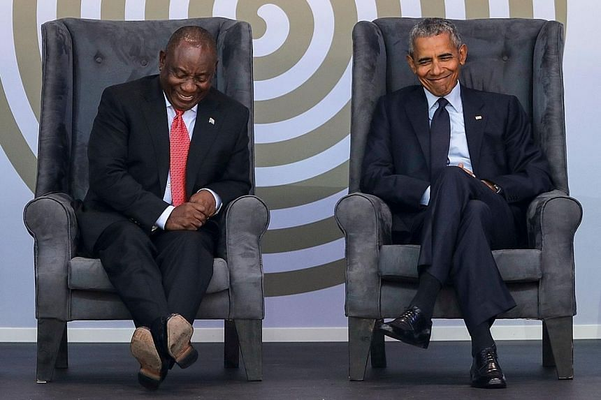 South African President Cyril Ramaphosa and former US president Barack Obama at the Nelson Mandela Annual Lecture held at the Wanderers cricket stadium in Johannesburg yesterday.