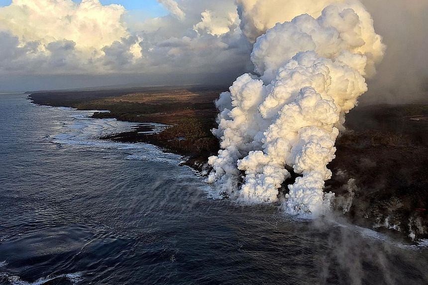 Above: A gaping hole in the roof of the tour boat that was struck by a blob of hot volcanic lava from the Kilauea volcano in Hawaii on Monday. Left: Plumes rising as lava poured into the sea on Sunday.Some tour boat passengers pay about $300 each for