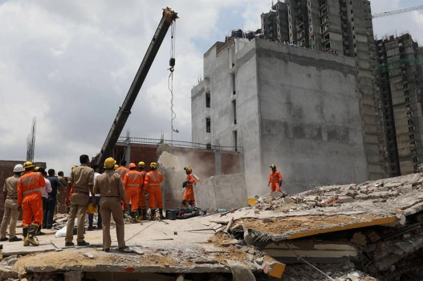 Indian National Disaster Response Force rescue workers at the site of a building collapse in Greater Noida, Uttar Pradesh, India, on July 18, 2018.
