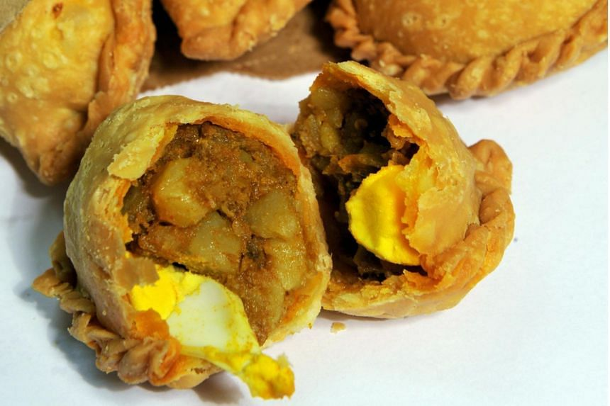 Rolina's curry puffs are hand-made throughout the day.