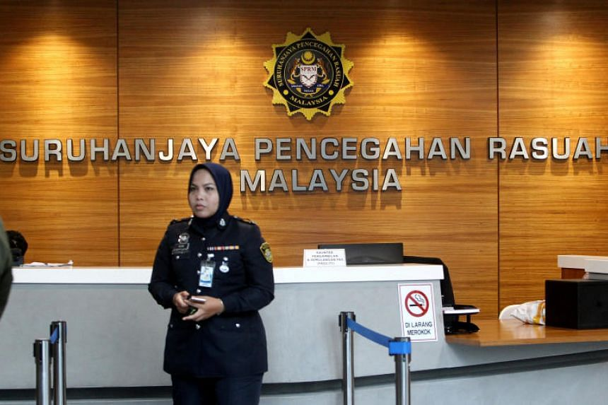 A member of the security personnel stands guard at the entrance of the Malaysian Anti-Corruption Commission (MACC) headquarters in Putrajaya, Malaysia, on July 3, 2018.