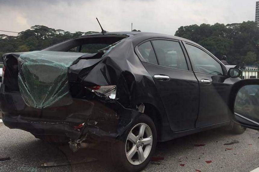 The rear of one of the cars was badly damaged, with the cracked rear window hanging over the boot.