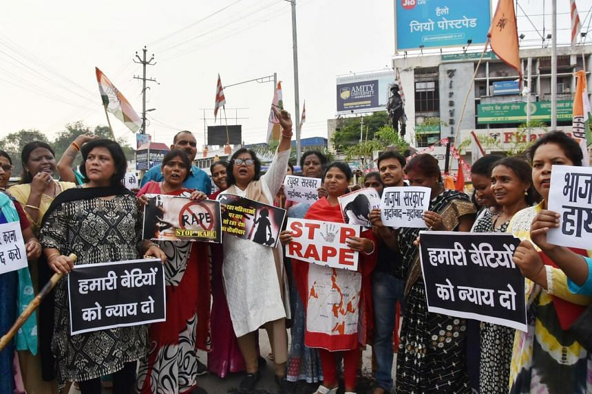 File photo showing activists holding a protest against the abduction and gang-rape of five charity workers in Chochang village of the Khunti district, in Ranchi, India, on June 23, 2018.