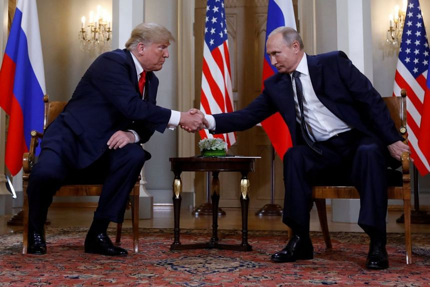 US President Donald Trump shaking hands with Russian President Vladimir Putin, who has repeatedly denied that Russia made any effort to interfere in the 2016 presidential election.