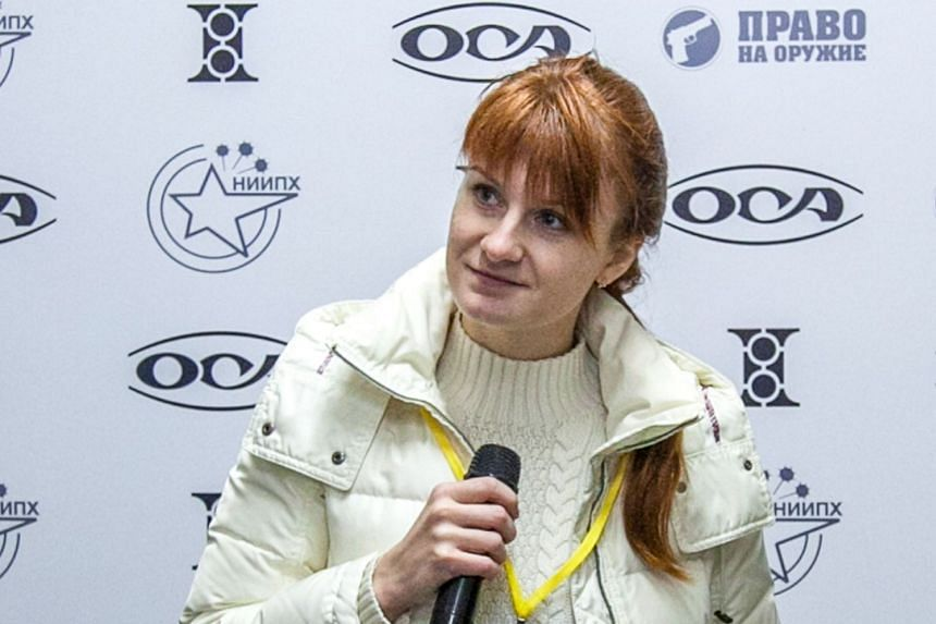 Mariia Butina, leader of a pro-gun organisation, speaks in 2013 during a press conference in Moscow.