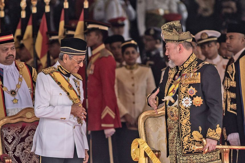 Malaysian Prime Minister Mahathir Mohamad with Malaysia's King, Sultan Muhammad V, at the opening of the first session of the new Parliament. The King's call to strengthen harmony came as some opposition members sought to stoke tensions by questi