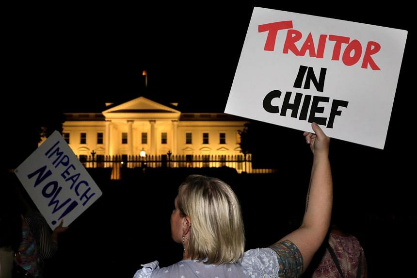Protesters rallying outside the White House on Monday after US President Donald Trump's return from Helsinki. Apart from opposition Democrats, the backlash over his remarks has largely been from Republicans who have nothing to lose.
