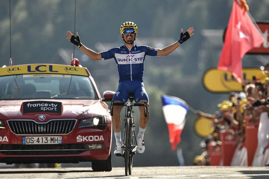 Alaphilippe celebrates as he crosses the finish line to win the 10th stage.