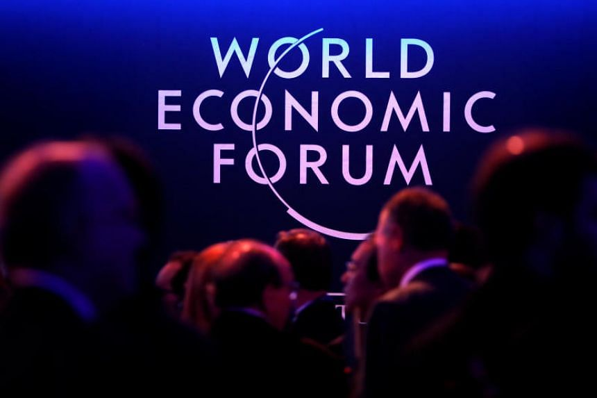 A logo of the World Economic Forum (WEF) is seen as people attend the WEF annual meeting in Davos, Switzerland. PHOTO: REUTERS