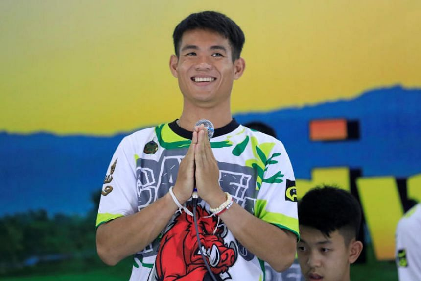 Coach Ekkapol Chantawong, 25, introduces himself during the news conference.