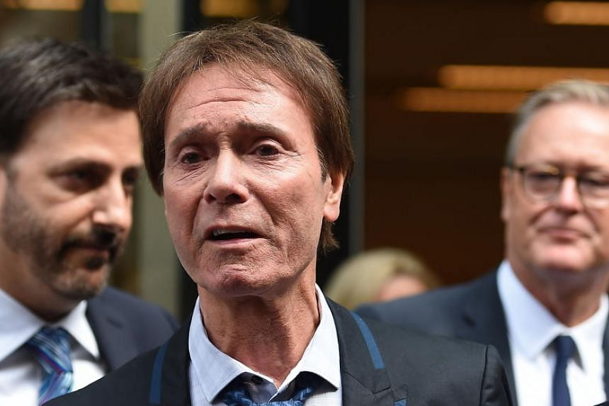 An emotional Sir Cliff Richard (centre) makes a short statement to the press outside the High Court in London, Britain, on July 18, 2018.