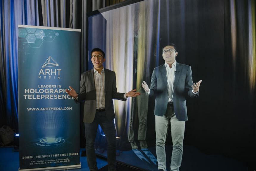 ARHT Media general manager Lincoln Cheung with a hologram of himself. The firm's hologram technology was developed at a cost of $9 million Canadian dollars (S$9.3 million).