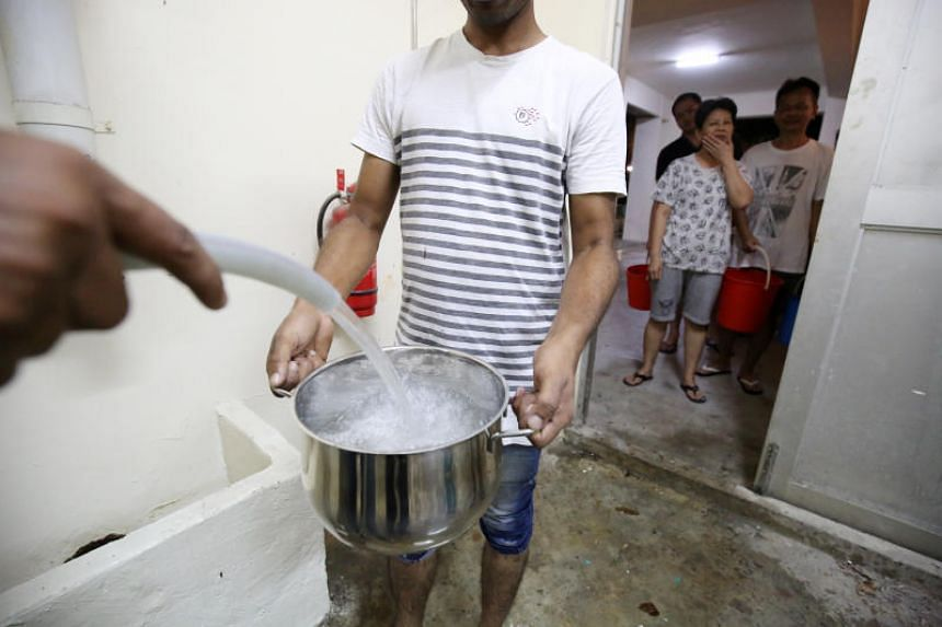 The disruption in water supply led to residents having to collect clean water supplied from seven water trucks that arrived at Block 290D Bukit Batok East Avenue 3 on July 17, 2018.