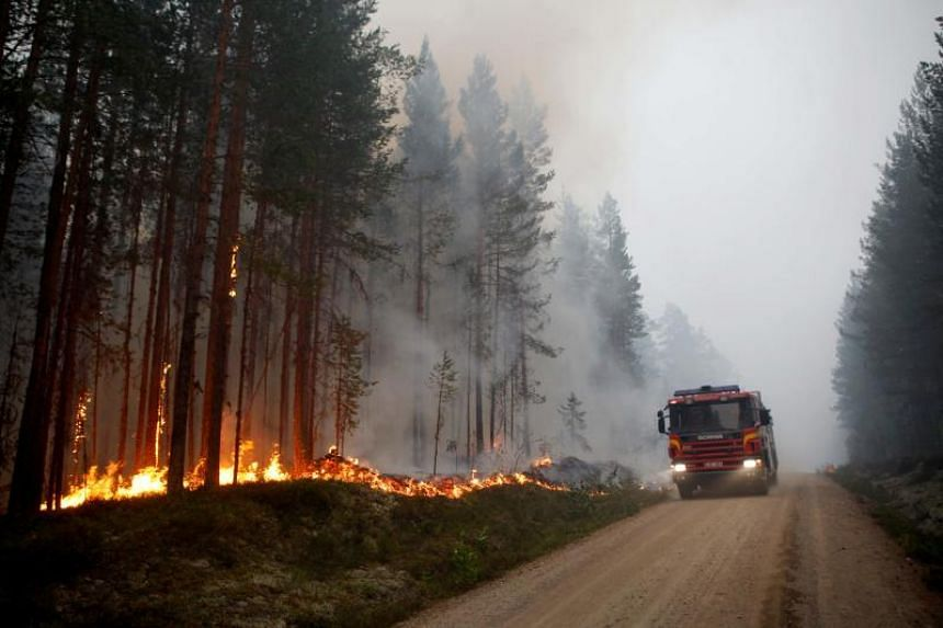 A fire vehicle dispatched to fight a fire in Karbole, Sweden, on July 15, 2018.
