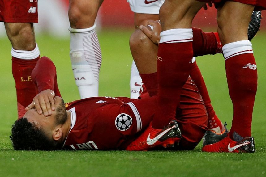 Liverpool's Alex Oxlade-Chamberlain after sustaining an injury against AS Roma.