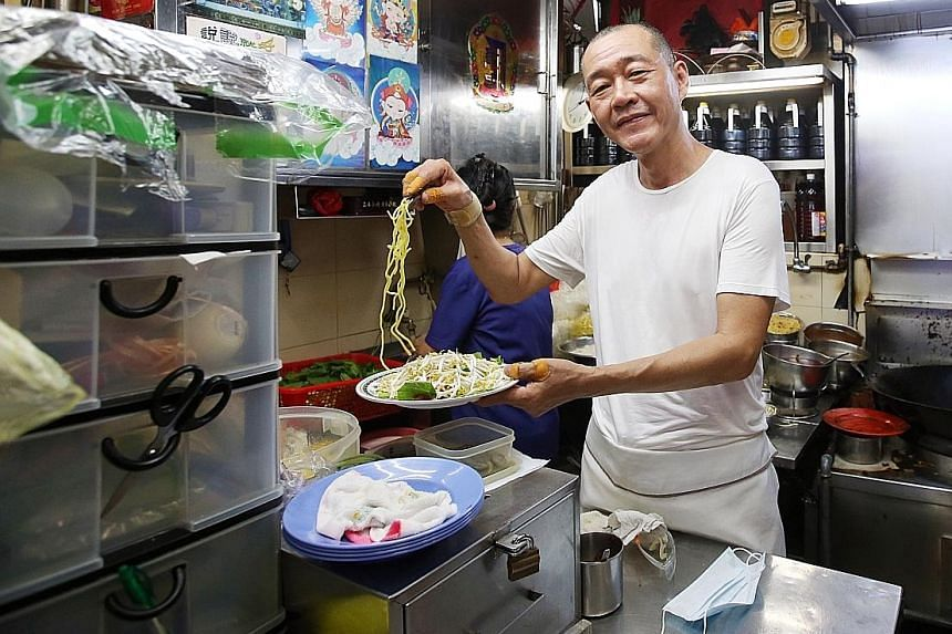 Mr Tan Lee Seng, owner of Lao Fu Zi Fried Kway Teow in Old Airport Road Food Centre.