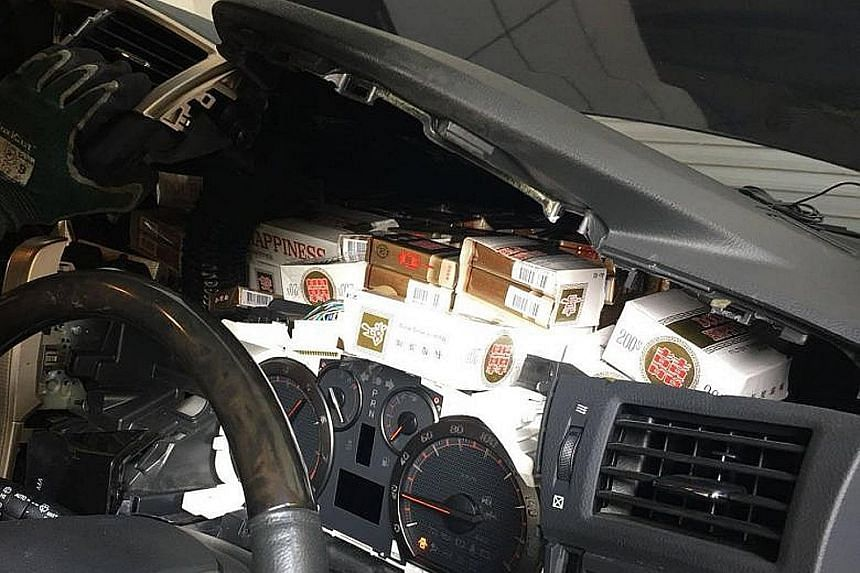 ICA officers found the duty-unpaid cigarettes in various places in the Malaysia-registered car, such as inside the modified dashboard.