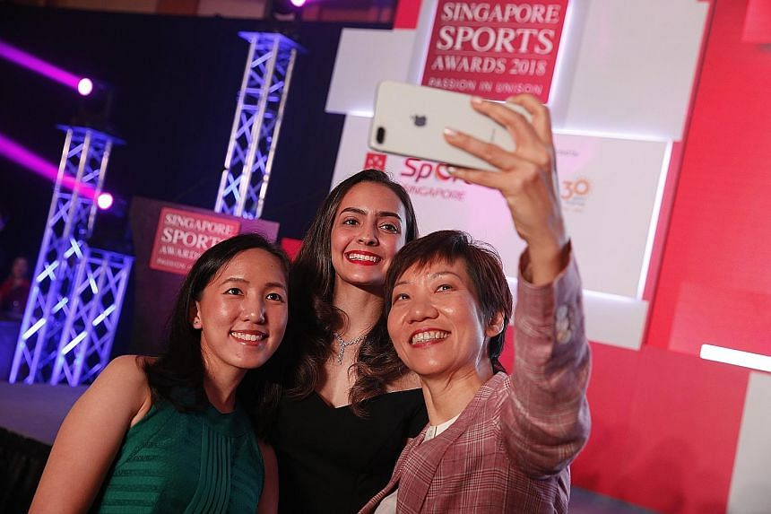 Above: Shooter Jasmine Ser and fencer Amita Berthier posing with Minister for Culture, Community and Youth Grace Fu. Right: Synchronised swimmer Debbie Soh received the Sportsgirl of the Year accolade. Joseph Schooling with his Sportsman of the Year