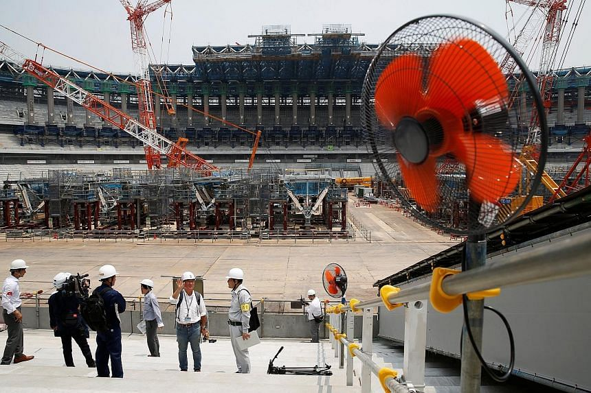 Electrical fans out in force during a heat wave at the construction site of the main stadium of the Tokyo 2020 Olympics. Experts have warned of the risk of heatstroke at the Games, and organisers are taking the issue seriously as they consider a raft