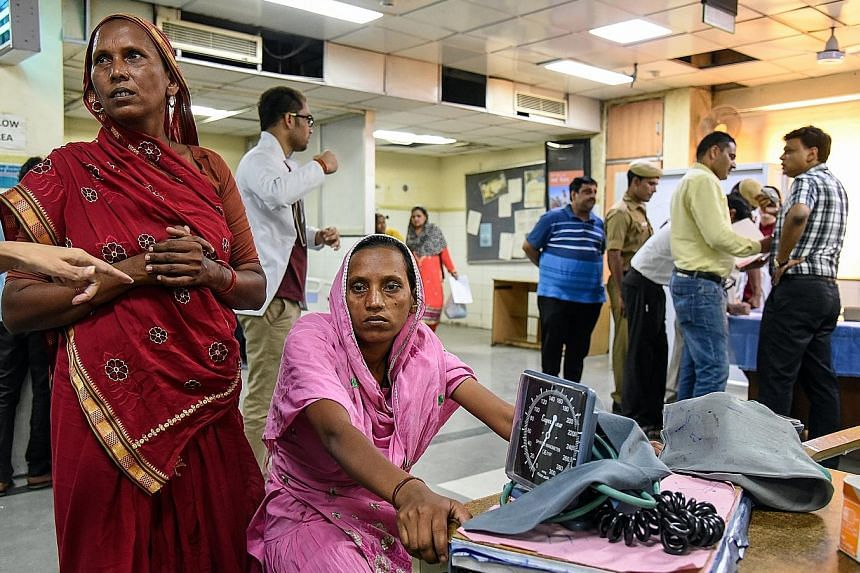 A woman in a New Delhi hospital waiting to be treated for heat stroke. Among the 100 most populous cities in the world where summer highs are expected to hit at least 35 deg C by 2050, 24 are in India.