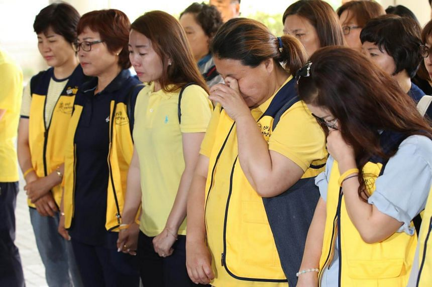 Family members of victims of the 2014 Sewol ferry sinking stand together for a press conference after a court ruling ordering the state to compensate them, in Seoul, South Korea, on July 19, 2018.