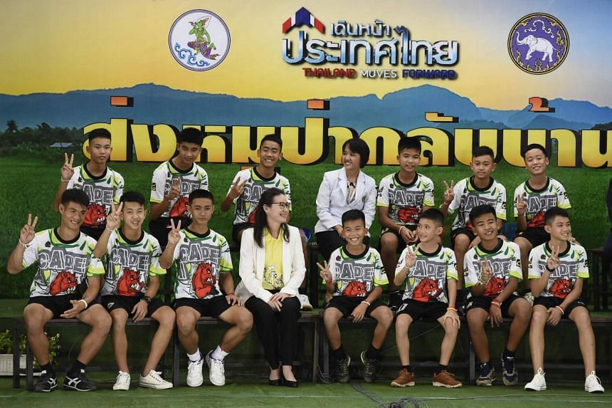 The 12 boys, aged 11 to 16, and their 25-year-old coach made their first televised public appearance along with two female health officers after being discharged from a hospital in the northern province of Chiang Rai, on July 18, 2018.
