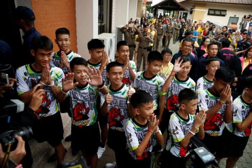 The 12 boys and their football coach arriving for a news conference in the northern province of Chiang Rai, Thailand, on July 18, 2018.