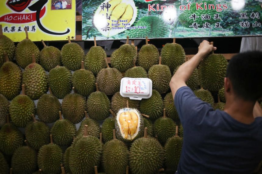 Durians for sale at Durian FullHouse next to Kovan Express Bus Terminal.