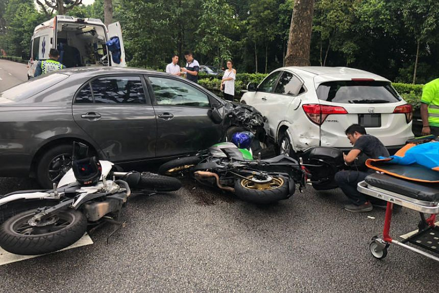 Paramedics on the Bukit Timah Expressway following the accident involving two cars and two motorcycles that took place on July 19, 2018.
