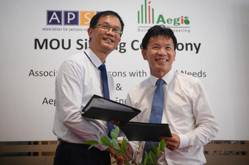 Association for Persons with Special Needs CEO Dr Christopher Tay (left) and Aegis Building and Engineering Pte Ltd managing director Yeong Wai Teck pictured after the MOU signing between both companies on July 19, 2018.