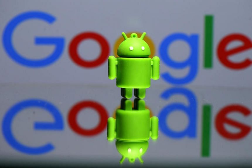 A 3D printed Android mascot is seen in front of a Google logo in an illustration photo taken on July 9, 2017.