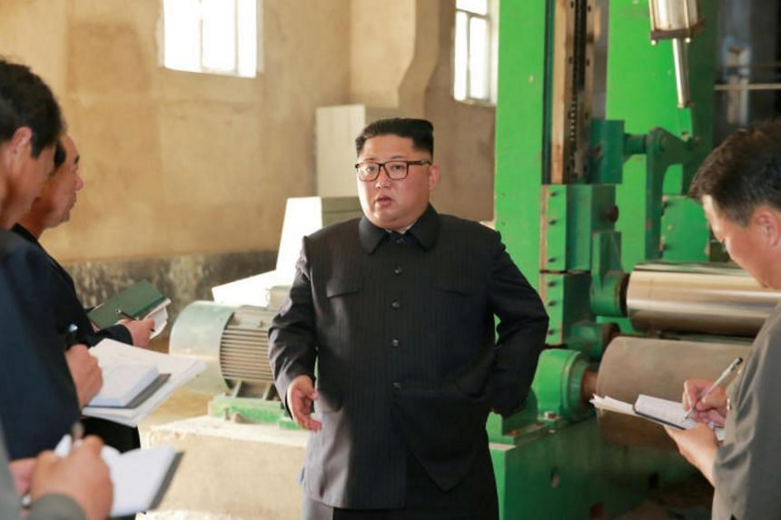 North Korea's leader Kim Jong Un tours a factory in Sinuiju, North Korea, in this undated photo released by North Korea's Korean Central News Agency, on July 2, 2018.