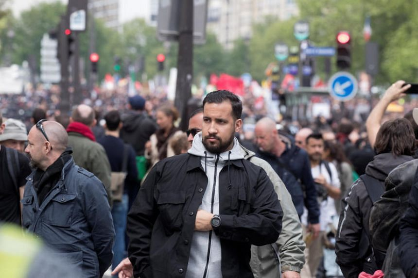 Le Monde newspaper published a video showing Mr Alexandre Benalla (pictured) hitting and then stamping on a young man while wearing a police visor during a demonstration in central Paris on May 1, 2018.