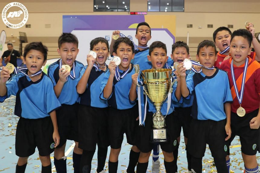 Young players from Woodlands Ring Primary celebrating after they were crowed winners of the Under-10 Singapore Pools-FAS Inter-School Futsal Challenge.