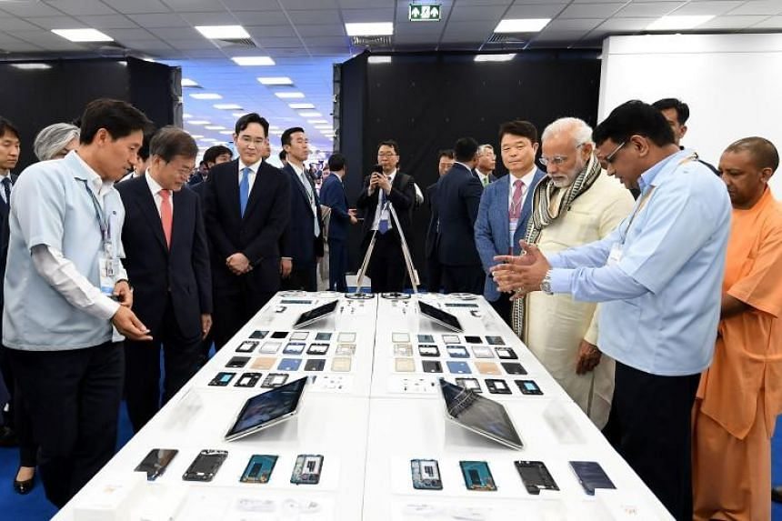 Indian Prime Minister Narendra Modi (third from right) and South Korean President Moon Jae-in (third from left) attend the inauguration of the world's largest smartphone factory in Noida, India, in a handout photo released on July 9, 2018.