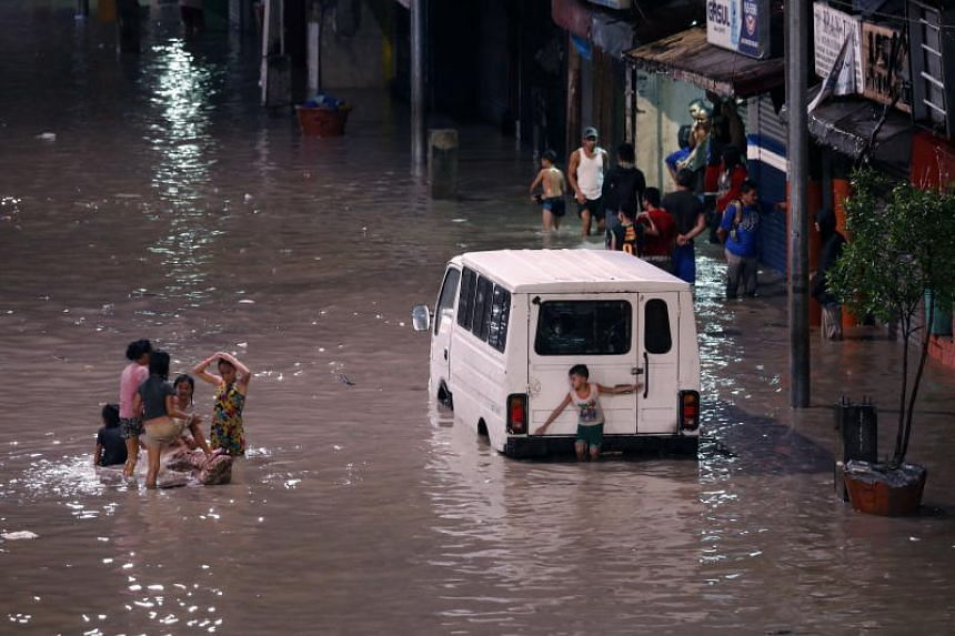 Flooded streets in Las Pinas city, south of Manila, Phiippines, on July 17, 2018, after Tropical Storm Son Tinh made landfall.