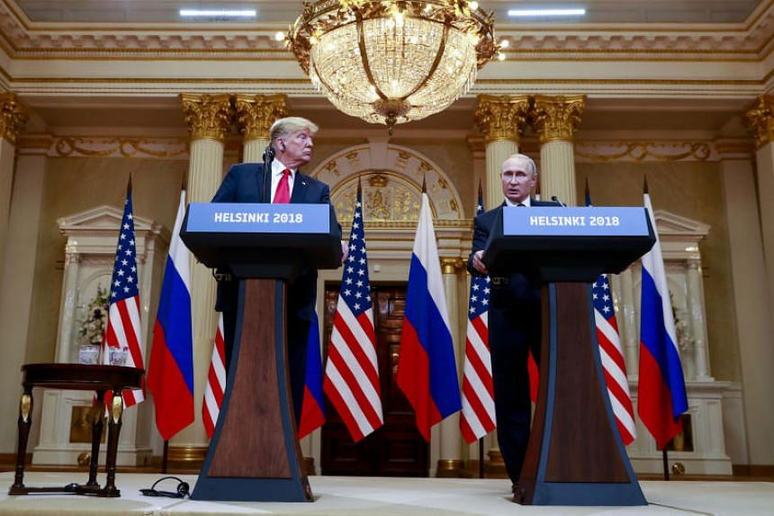 US President Donald Trump (left) and Russian President Vladimir Putin appear at a joint news conference in Helsinki, Finland, on July 16, 2018.